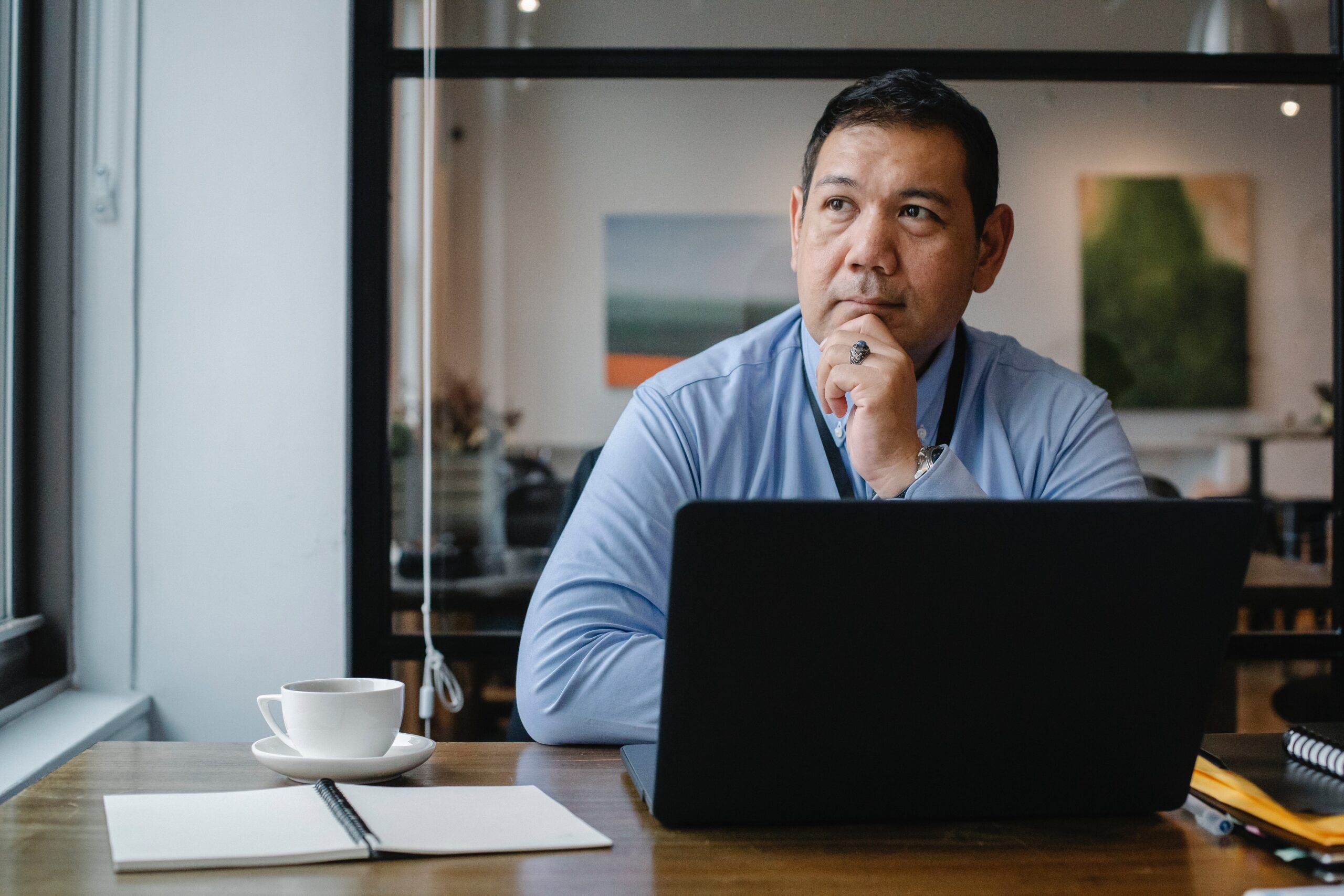 man sitting at laptop looking pensive
