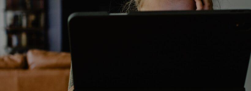 woman behind computer screen