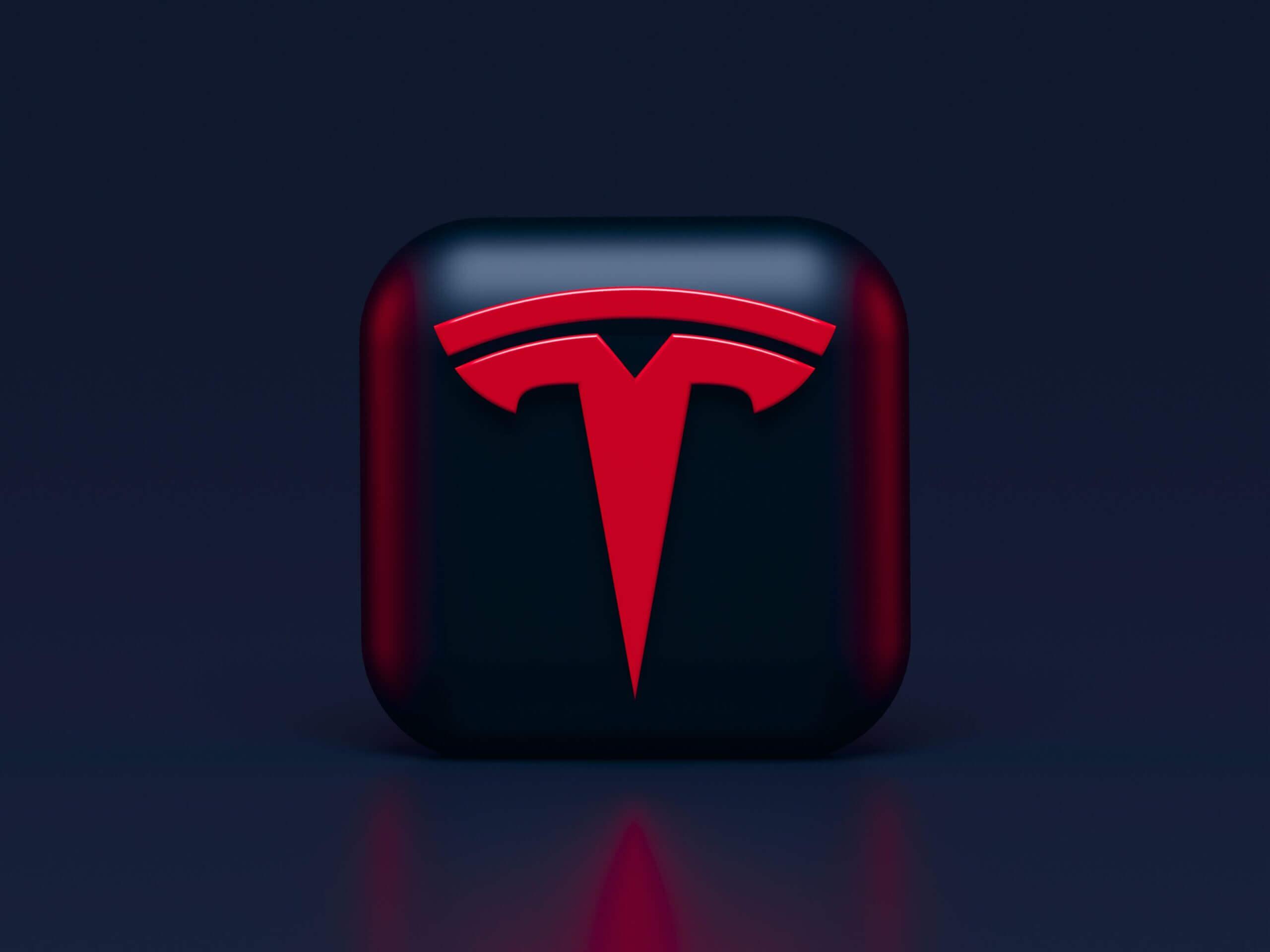 Tesla logo in red on black