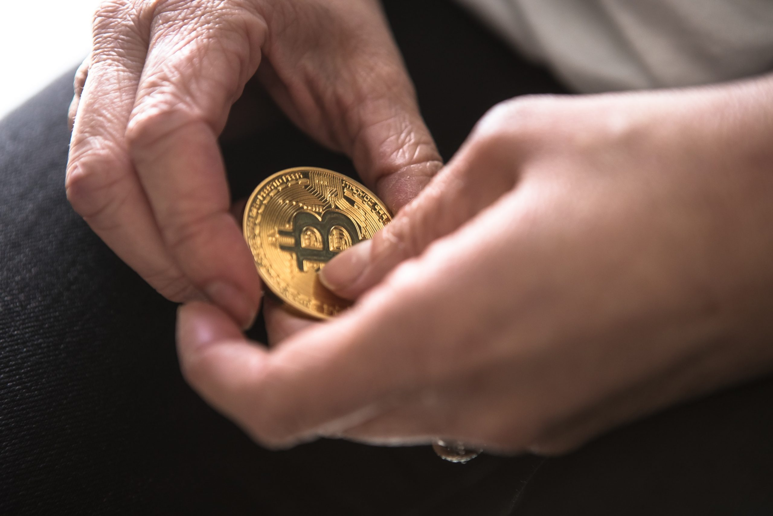 close-up of hands holding bitcoin