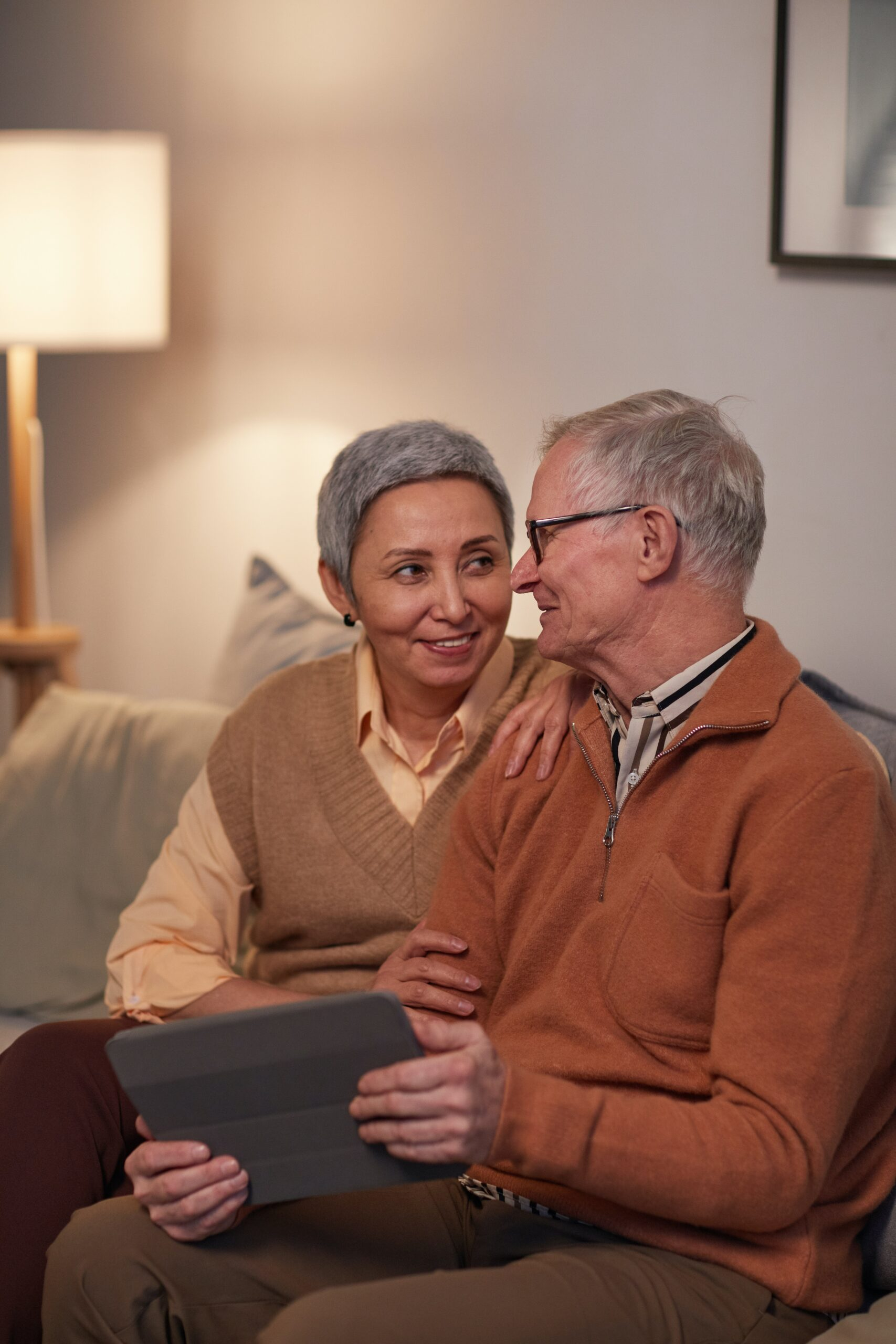 senior couple sitting on couch at home
