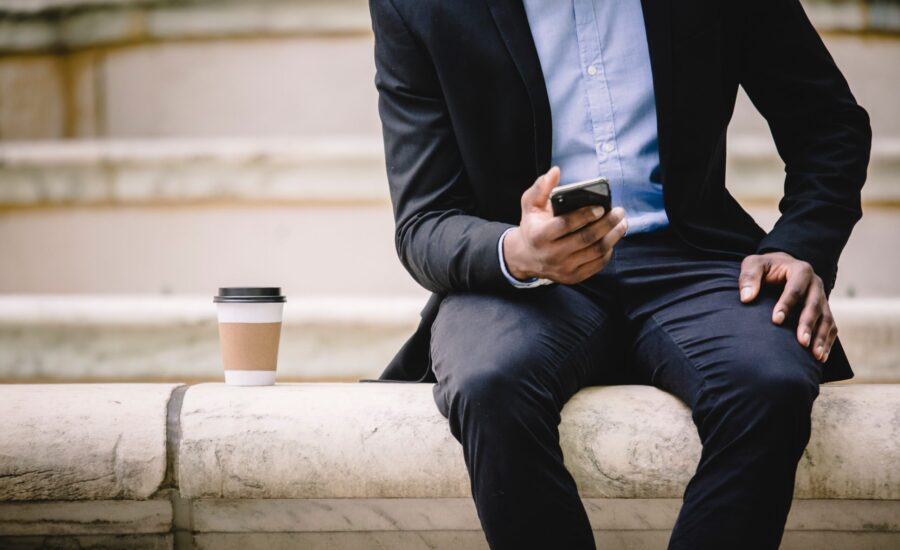 man reading smartphone on coffee break