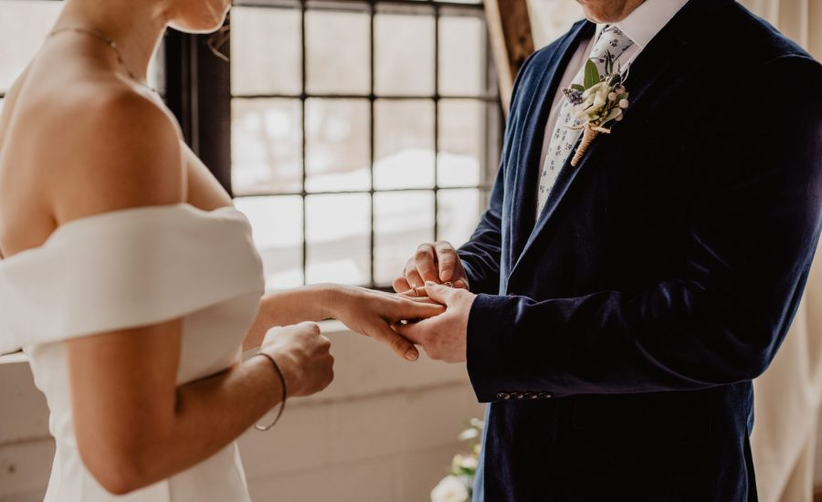 couple getting married by window