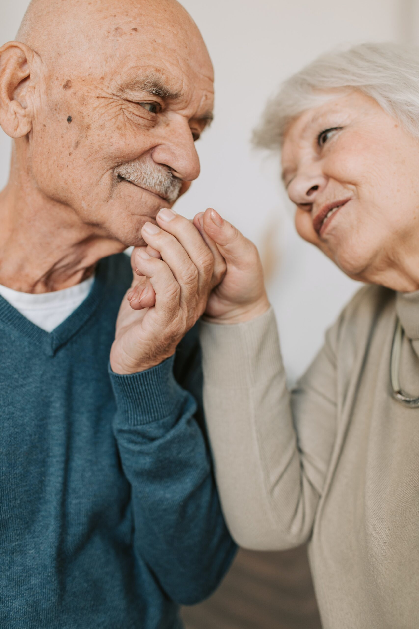 retired couple looking lovingly at each other