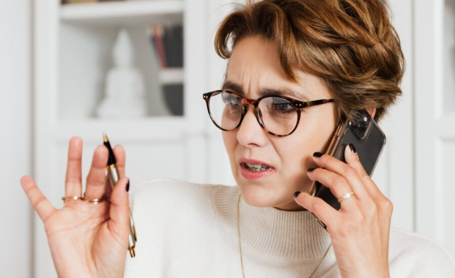 woman on phone with a concerned expression