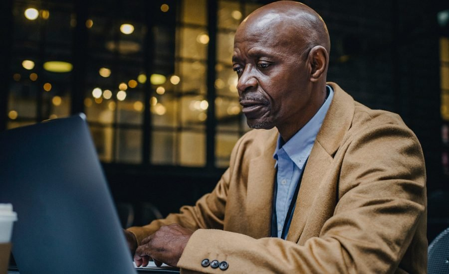 older man at laptop computer