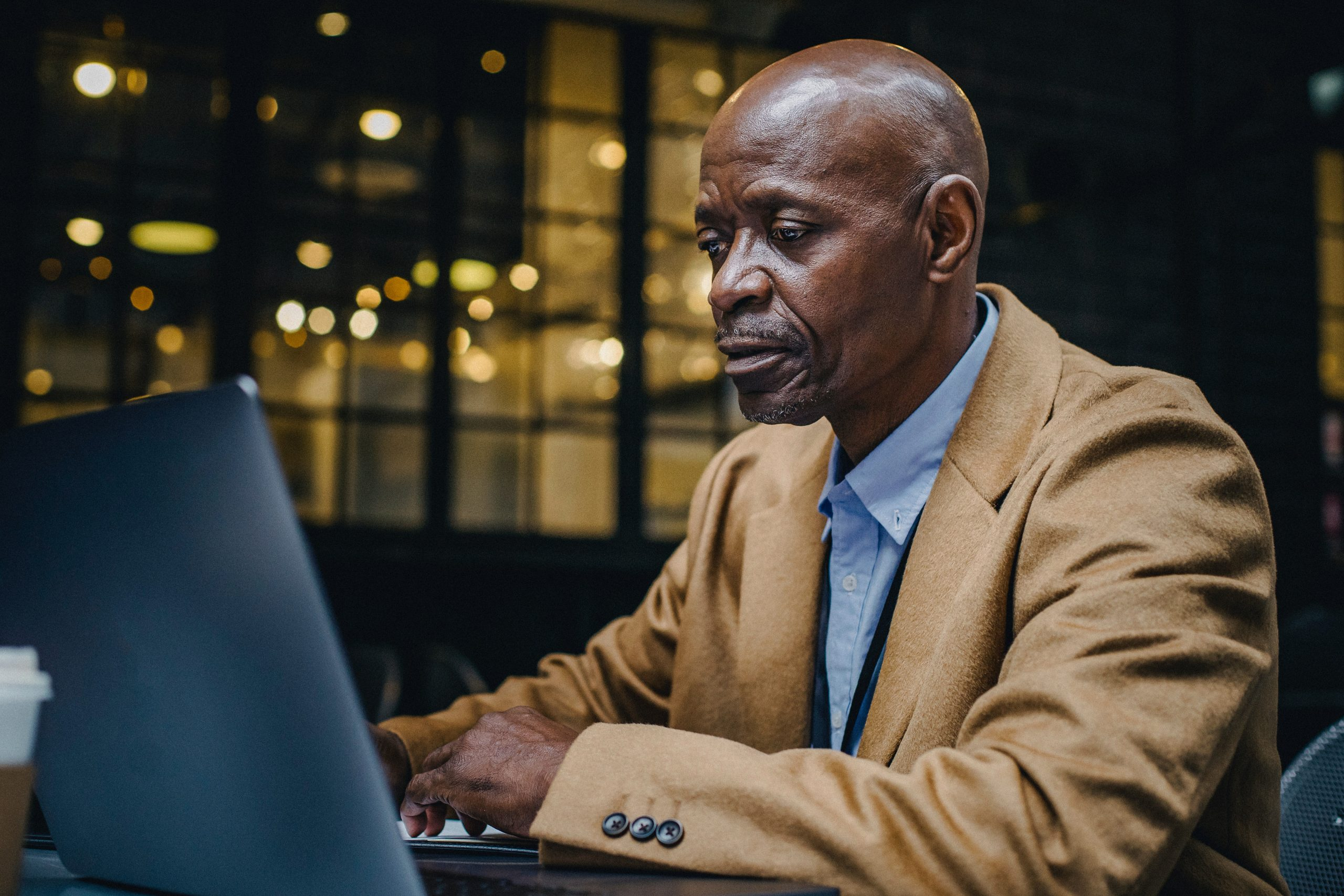 older man at laptop computer