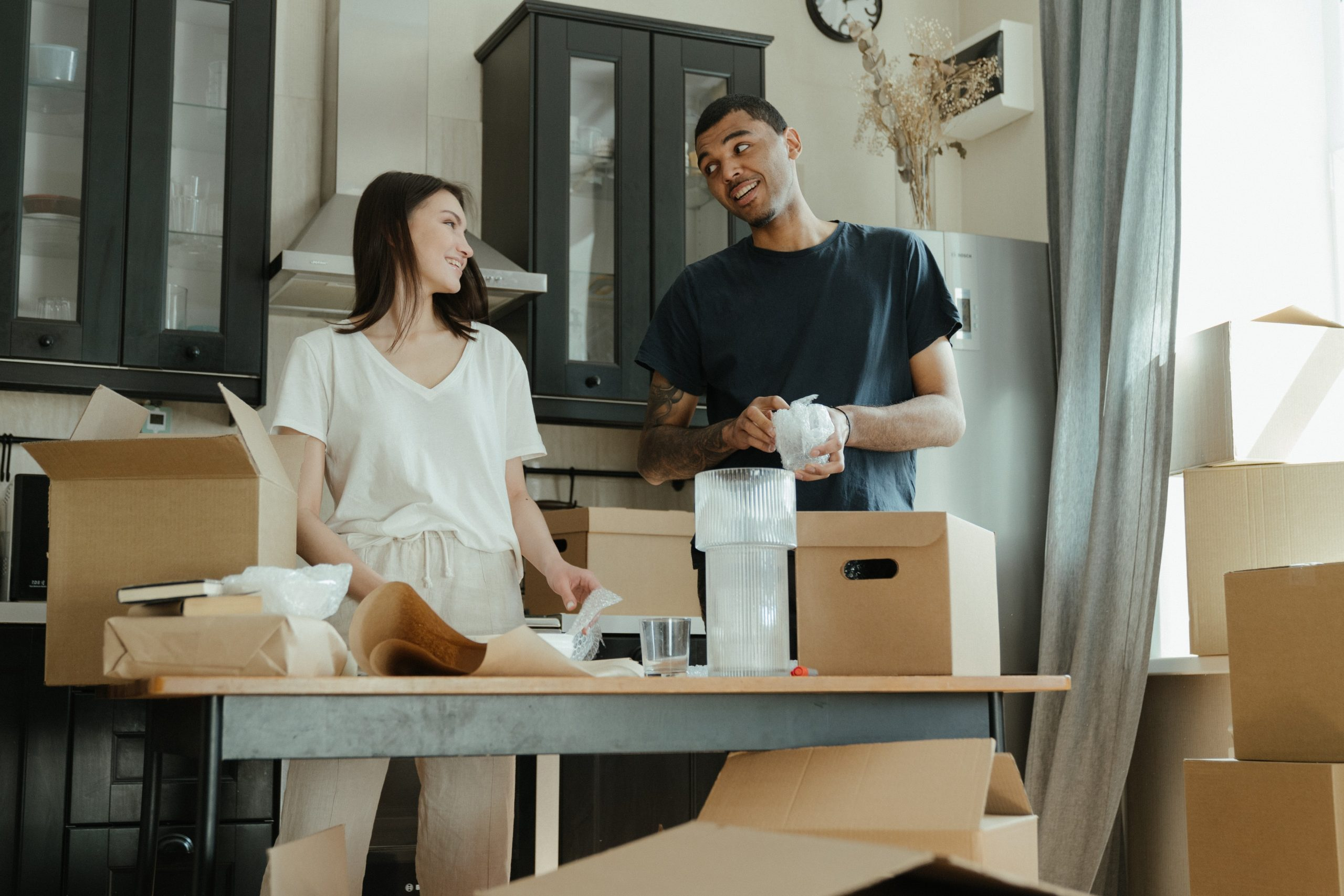 woman and man packing boxes for move