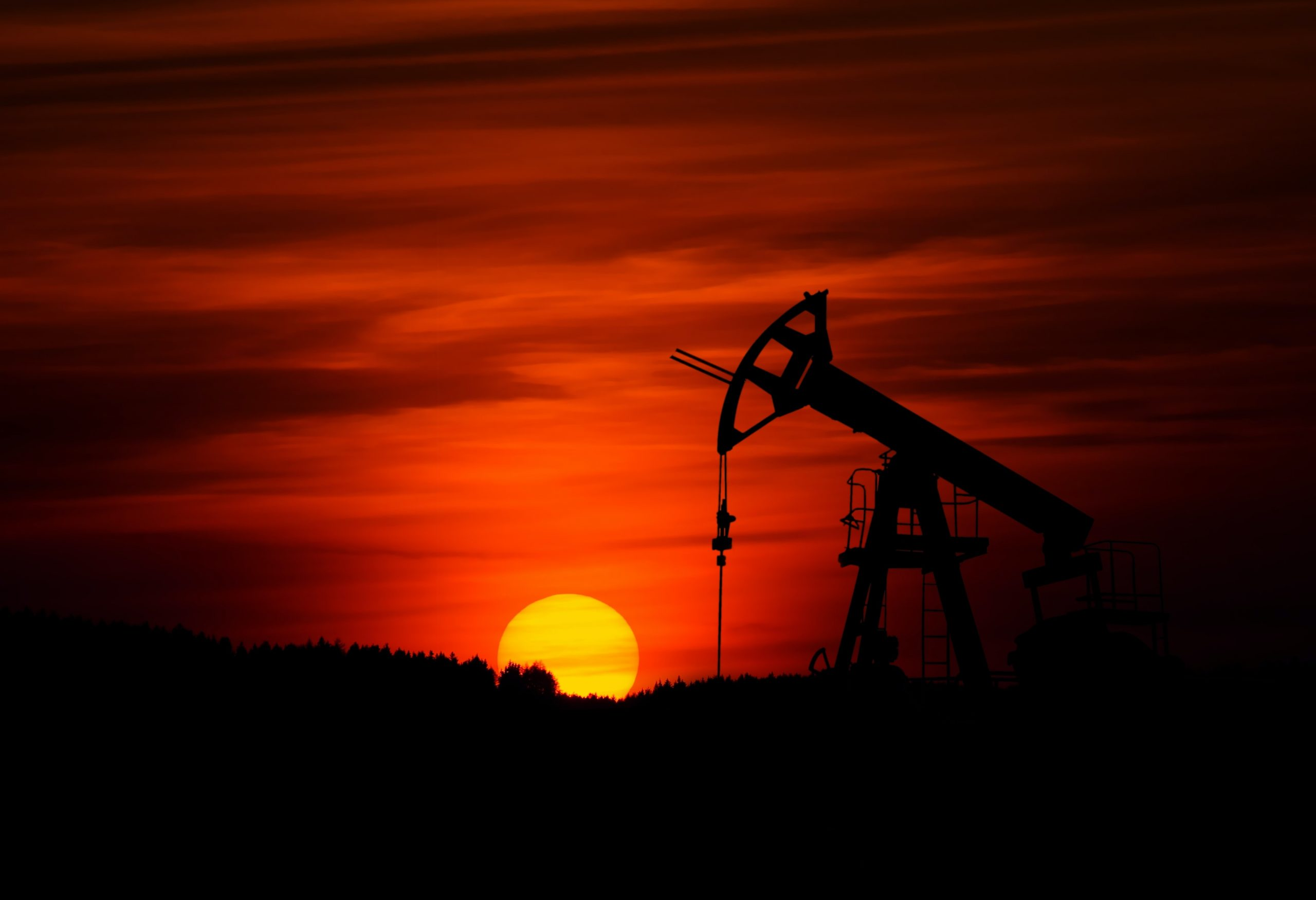 pumping oil at sunset