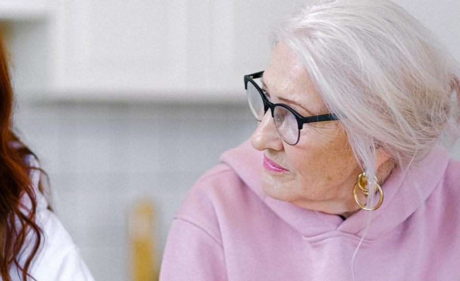 white-haired woman in her kitchen