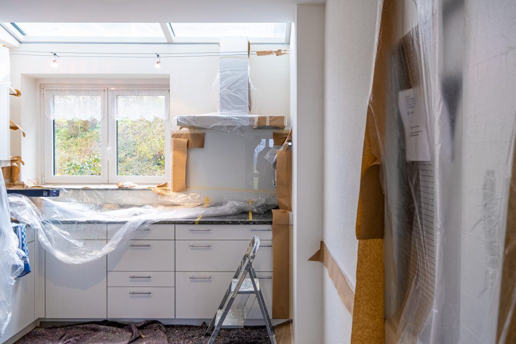 a kitchen set up in a home renovation