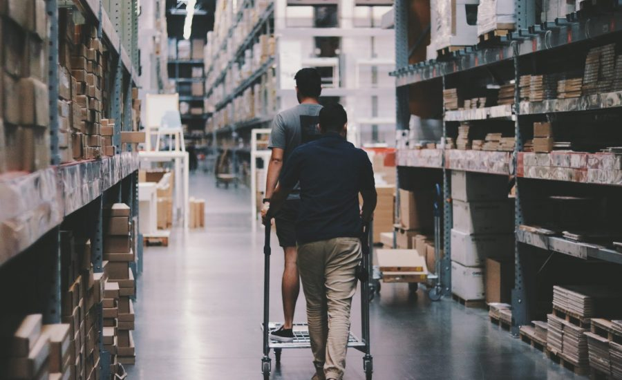 two men with a cart in warehouse