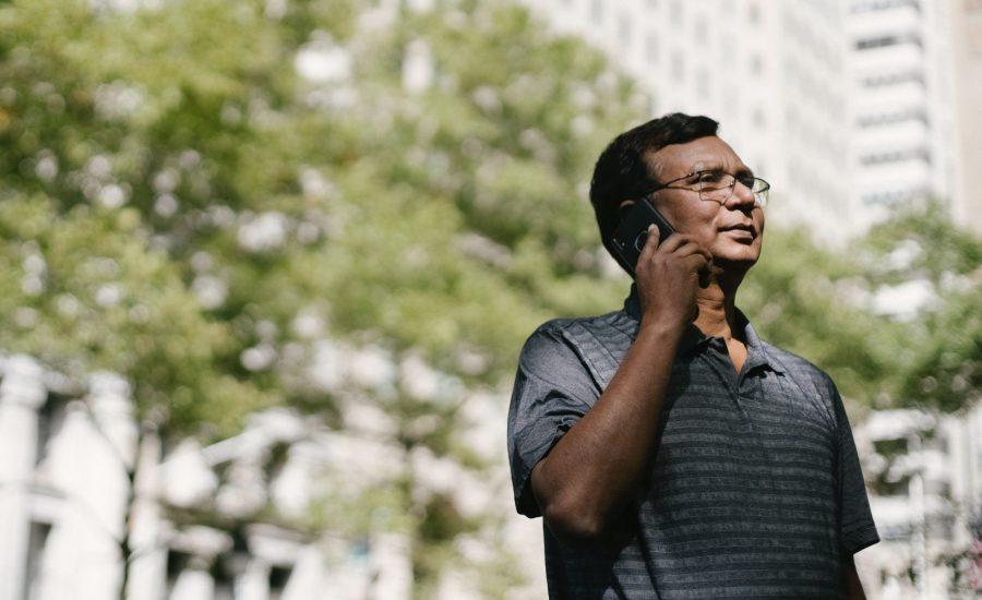 older man speaking on mobile phone