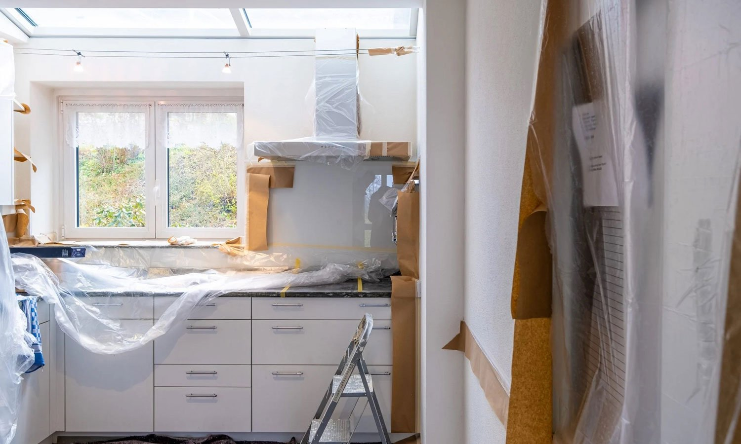 A freshly renovated kitchen with slick new cupboards and new applianes.