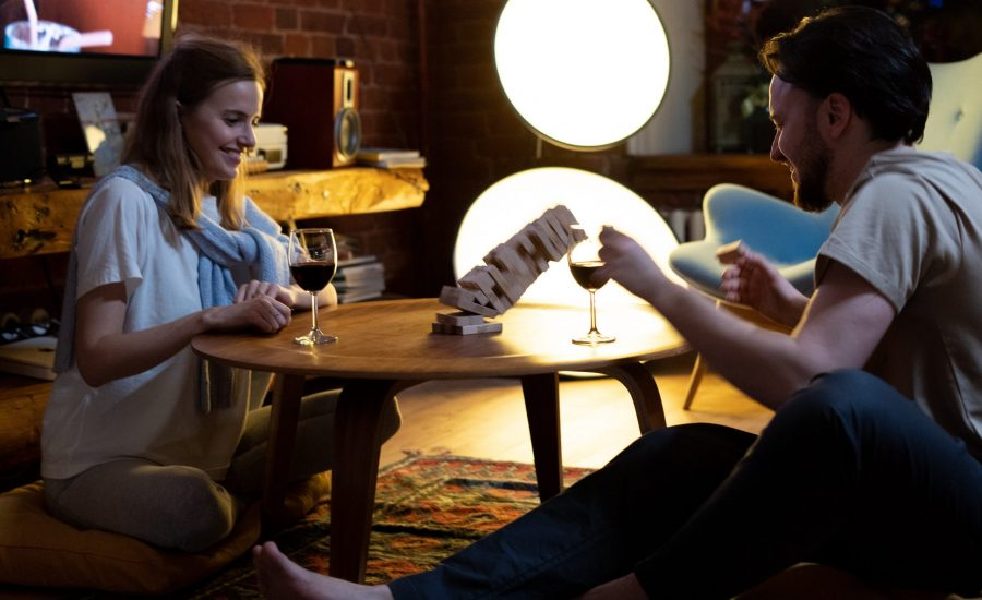 couple at home playing Jenga and drinking wine