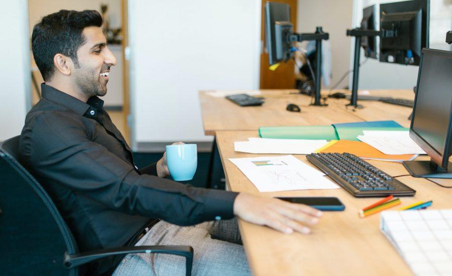 smiling man at desk