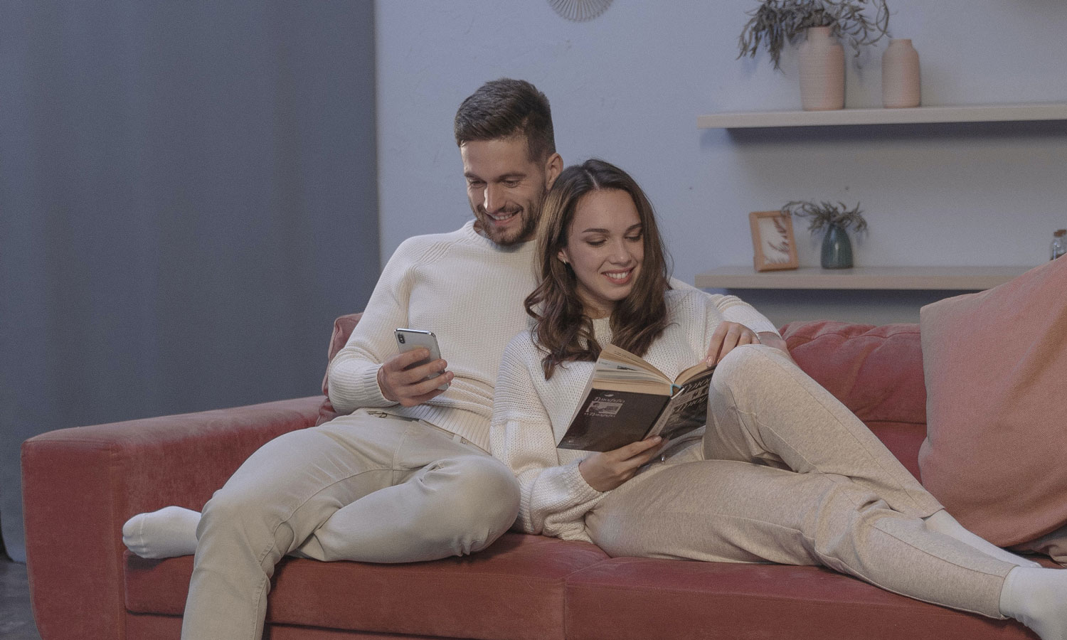 A couple on a couch, with