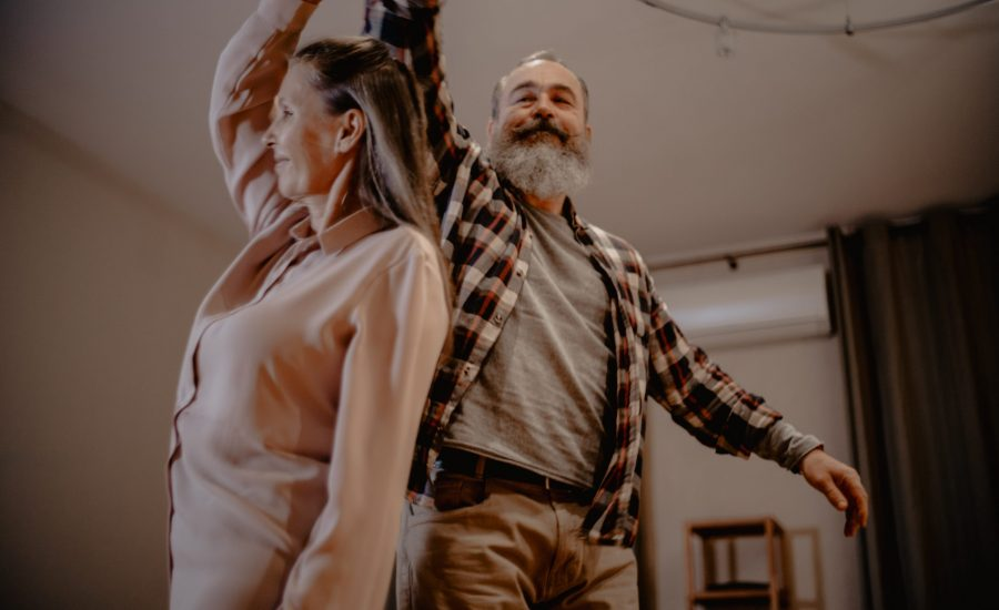 older couple dancing in their living room