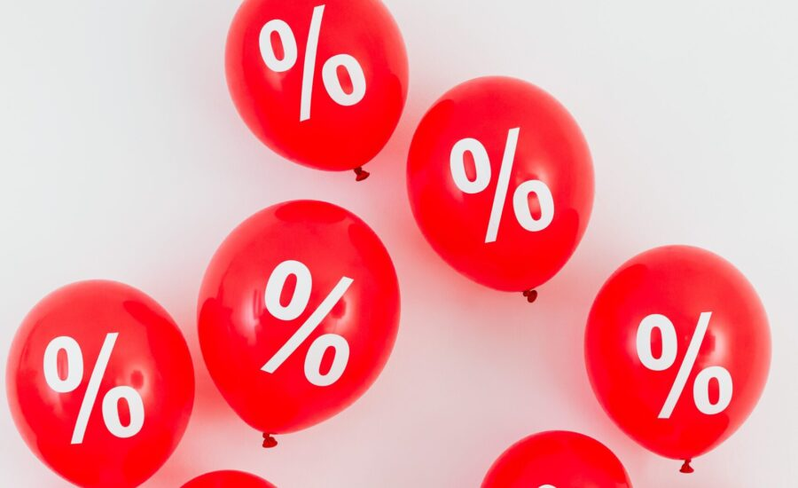 red balloons printed with percentage signs