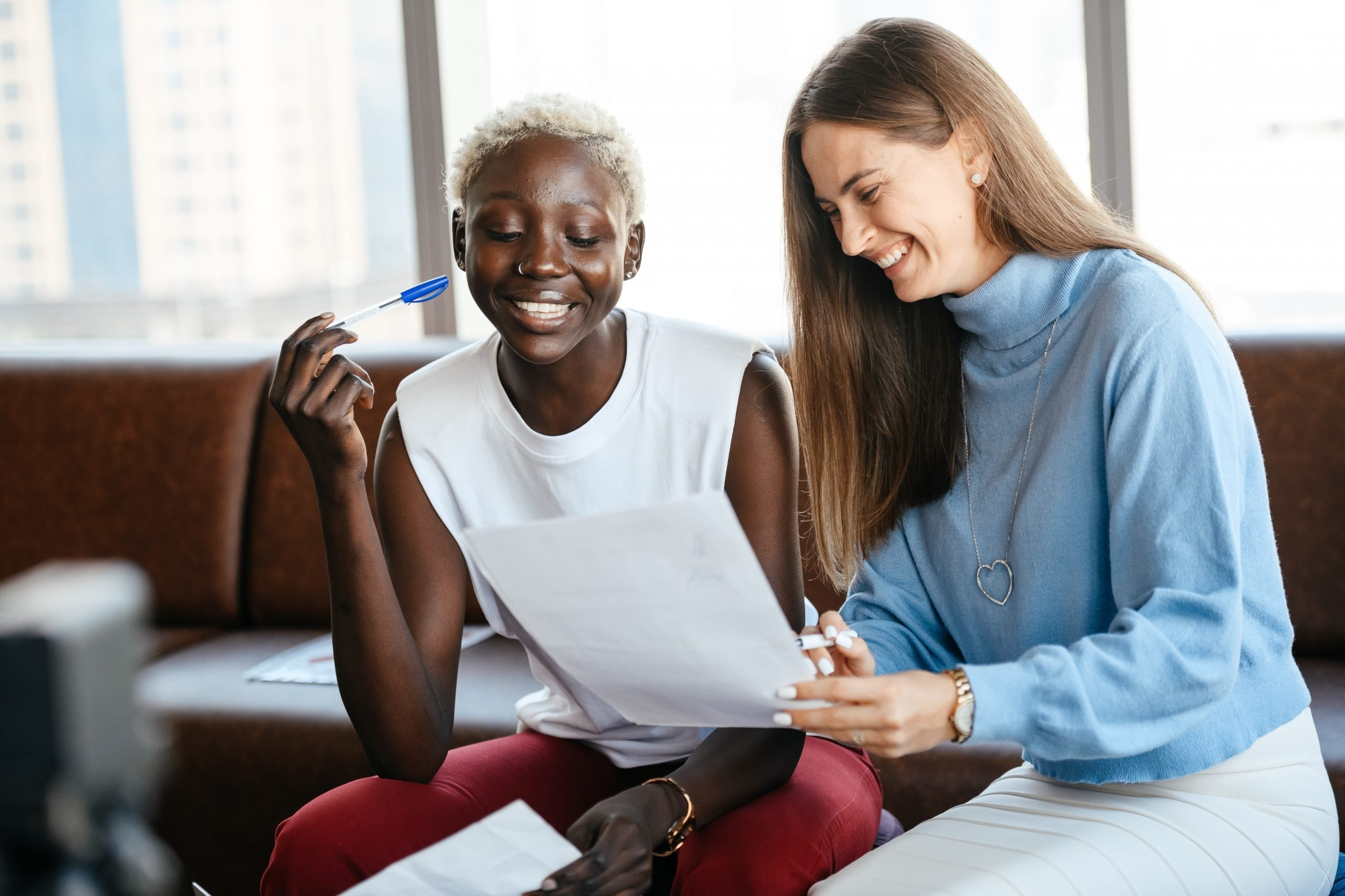 two women signing restrictive covenant in office