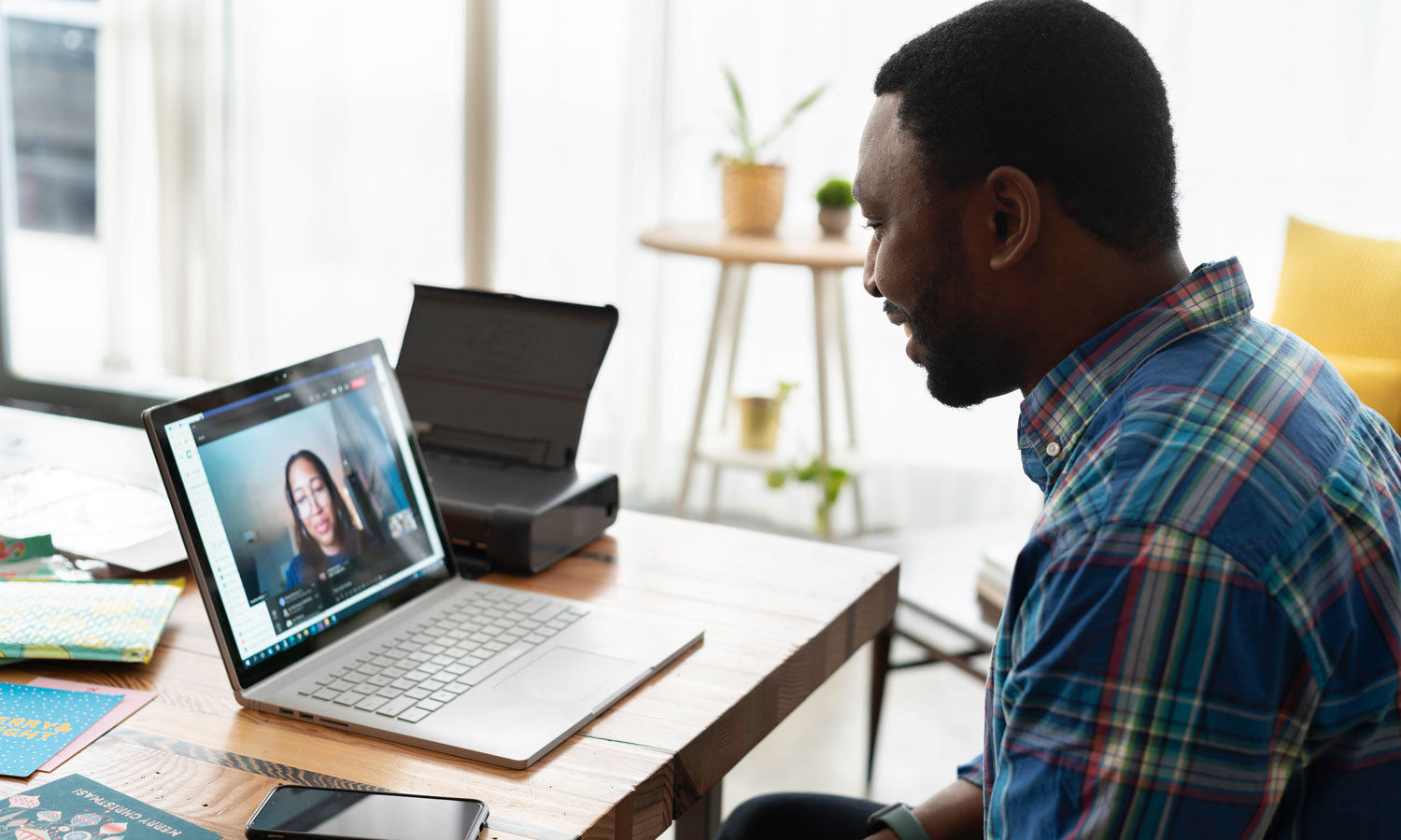 man on video call with coworker