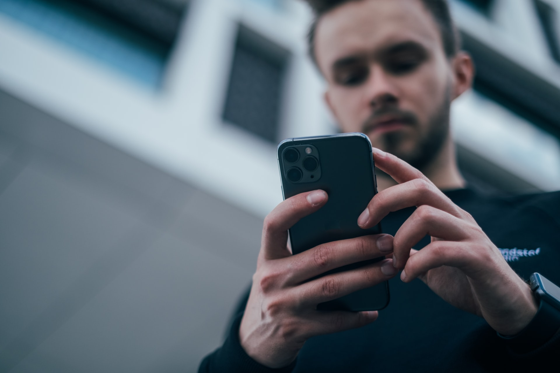 Man looking at phone for how to buy cardano in Canada