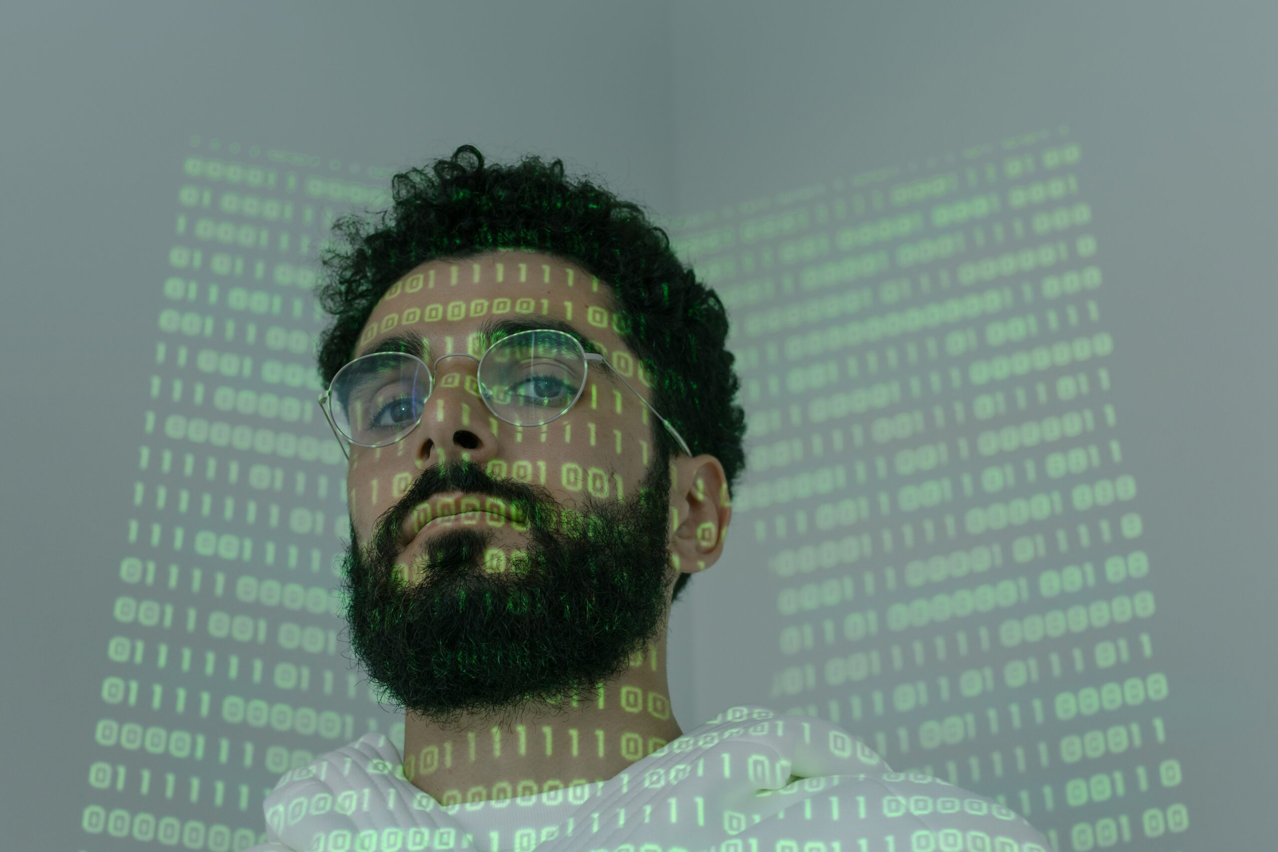 man with code projected on his face