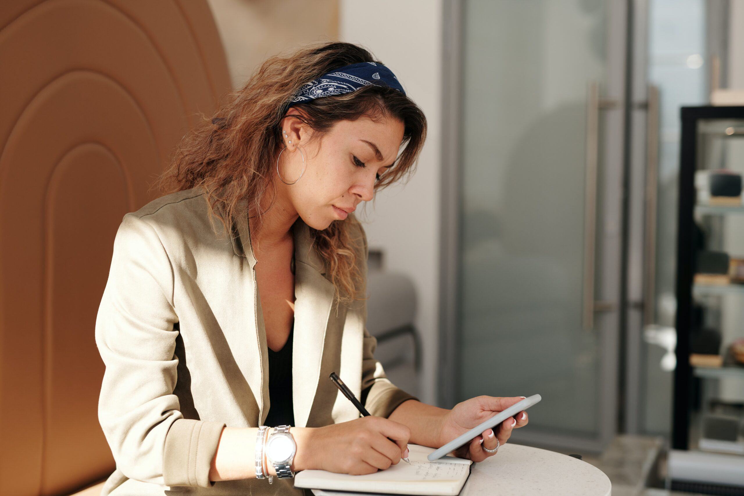 woman looking down at calculations