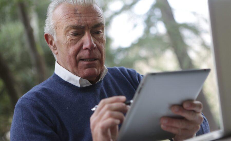 man checking investment statement