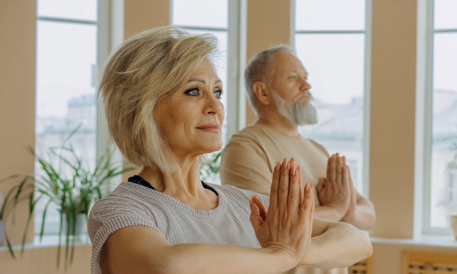 A couple enjoying a yoga class in their retirement